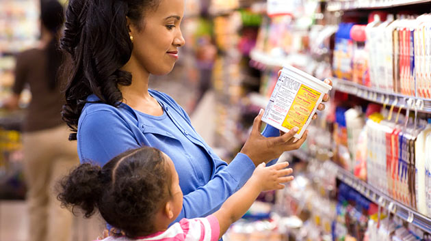 shoppers reading labels